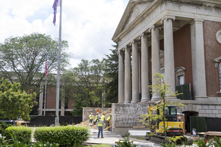 Construction crews work on the new steps that lead to the entrance of Hendricks Chapel. Photo taken by July 11, 2017